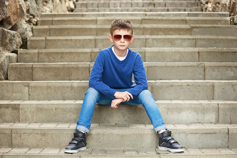 boy with shades on steps